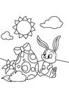 Disegno da colorare Coniglietto di pasqua con l'uovo di Pasqua Nel giardino
